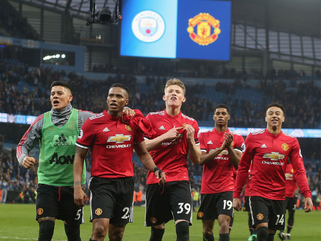 Marcos Rojo, Antonio Valencia, Scott McTominay, Marcus Rashford and Jesse Lingard of Manchester United celebrate after the Premier League match between Manchester City and Manchester United at Etihad Stadium on April 7, 2018 in Manchester, England. PHOTO: GETTY