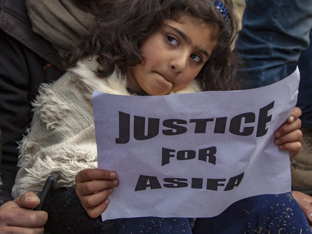 a child holds a placard as she takes part in a protest demanding the death penalty for the suspects in the rape and murder of eight year old asifa photo getty