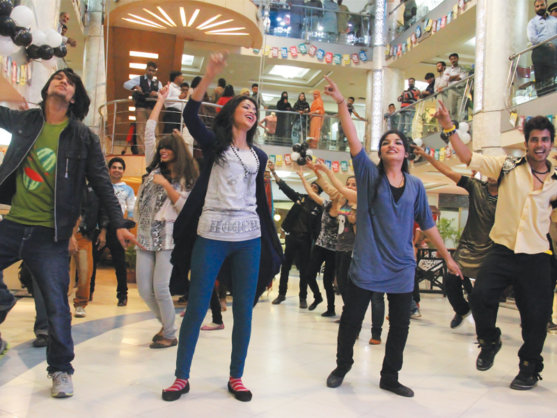 a flash mob sends an anti piracy message through their moves as they dazzle the crowd at park towers on friday photo ayesha mir express