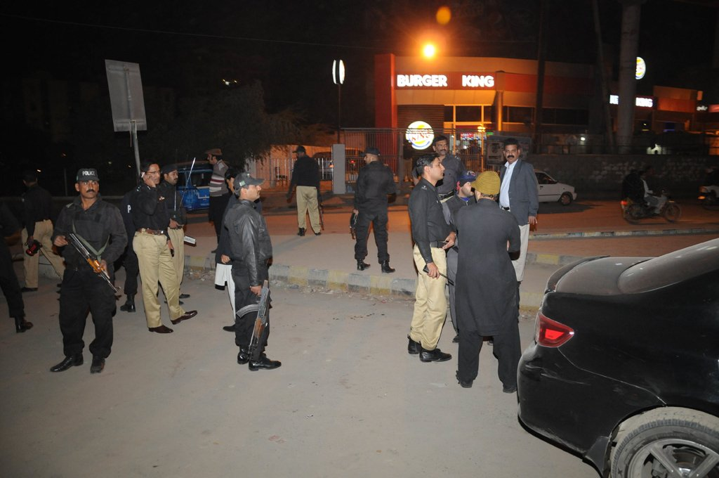 police officials inspecting the area after the attack on express news van on january 17 2014 photo express mohammad noman