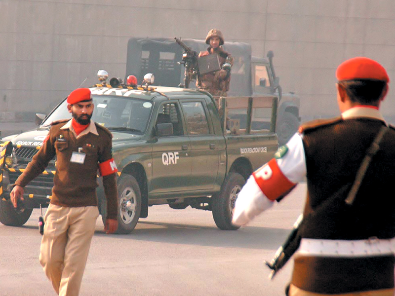 pakistan army troops arrive at the site of the suicide blast photo nni