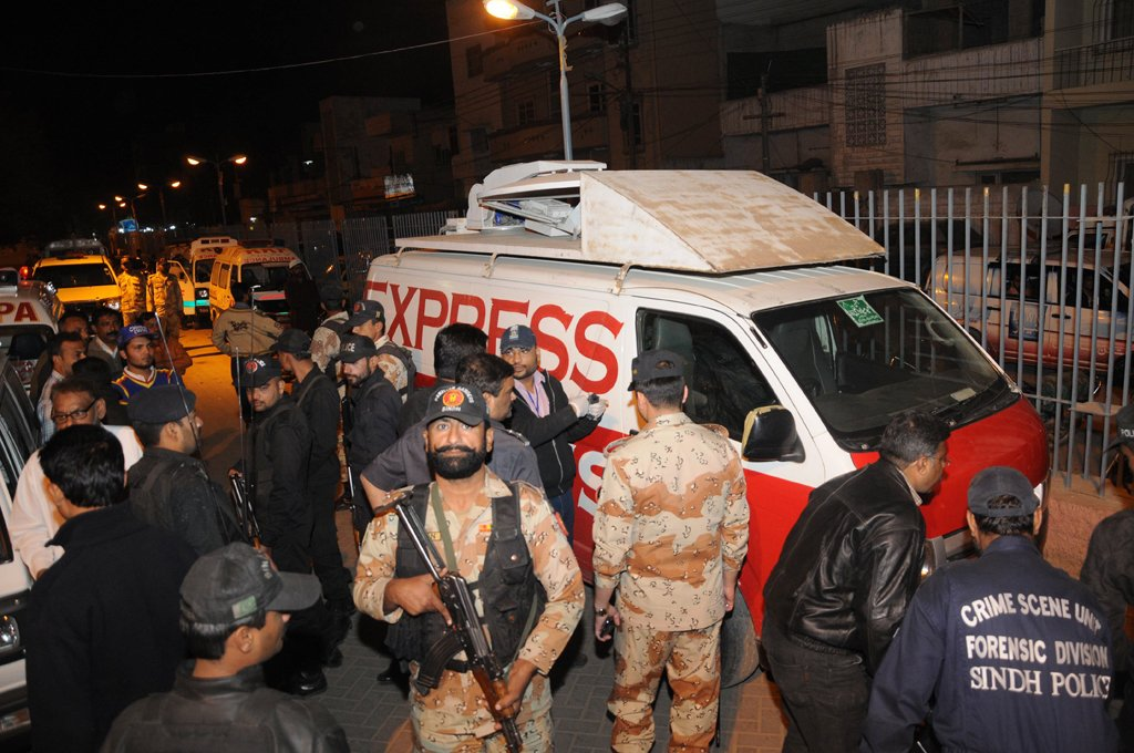 Officials collecting evidences off the DSNG van. PHOTO: EXPRESS/MOHAMMAD NOMAN