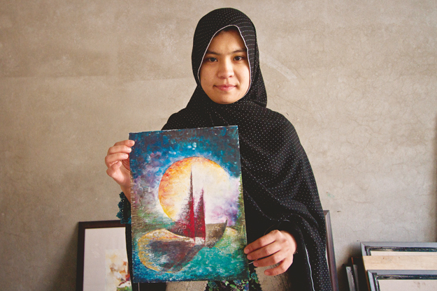a student at the sketch club displays her painting of a boat that depicts the horrors that confront hazara asylum seekers escaping to australia photos danial shah