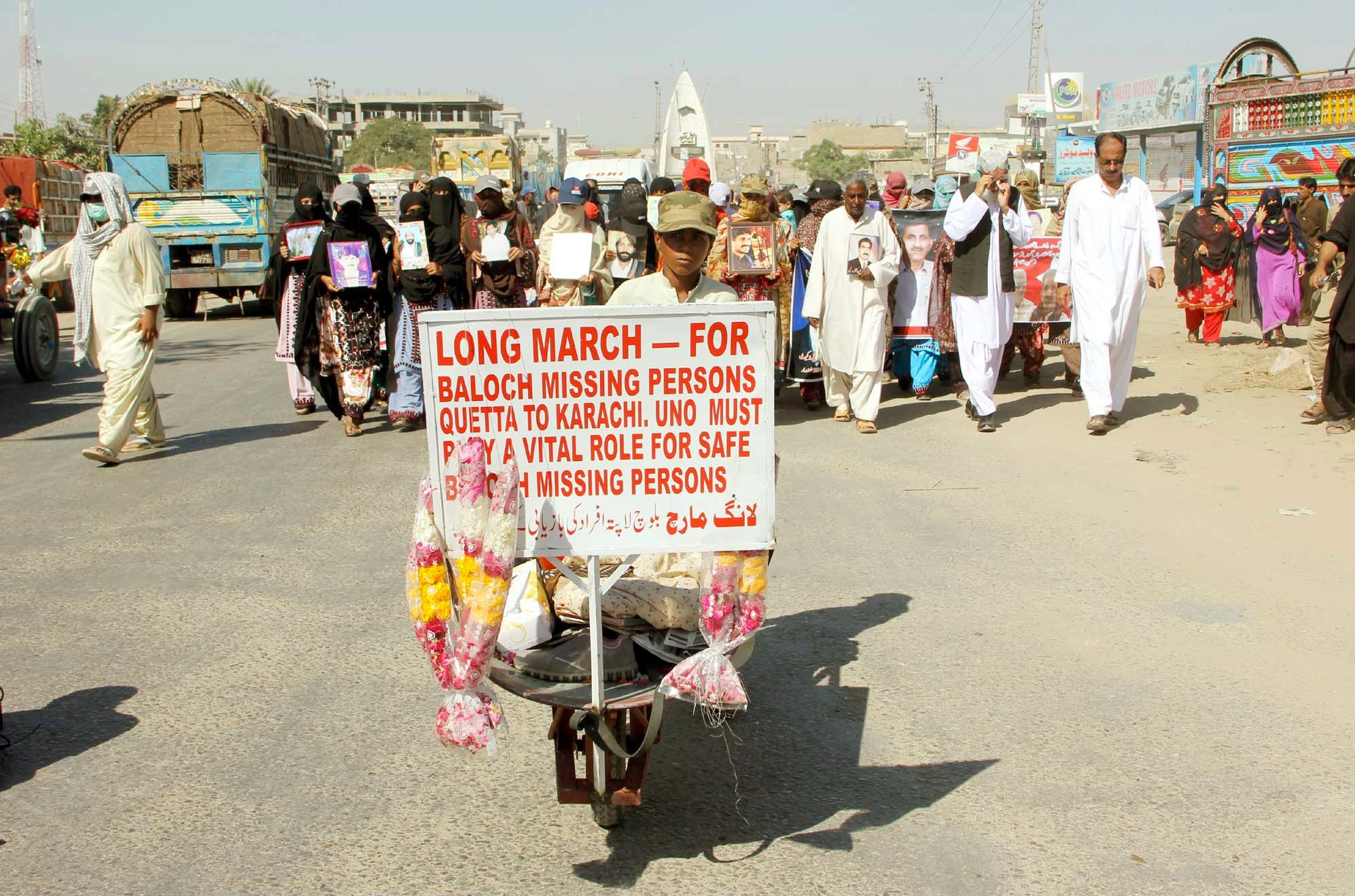 relatives of missing persons pass through a road during long march rally 21 11 2013 photo ppi
