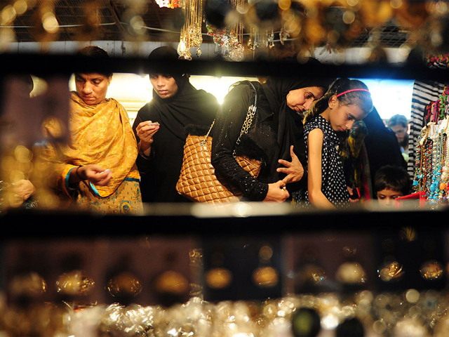 women in karachi shopping for jewellery at a market in preparation for eidul fitr photo afp