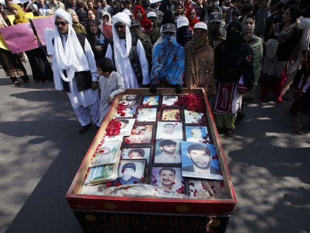 long march participants place portraits of their missing relatives on a push cart photo reuters