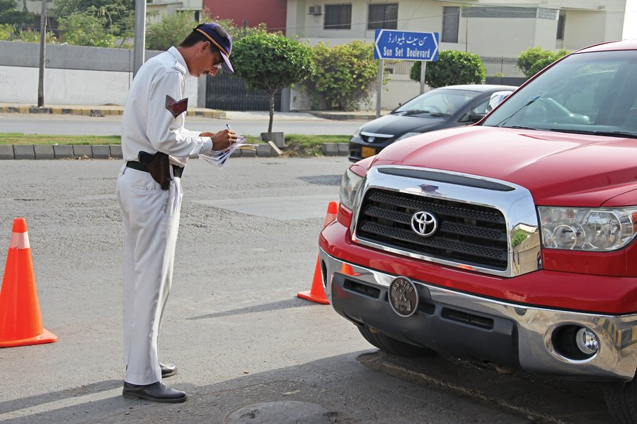 Vehicles can be seen throughout Karachi with government number plates but many of them are unregistered and do not pay taxes. PHOTO: AYESHA MIR/EXPRESS
