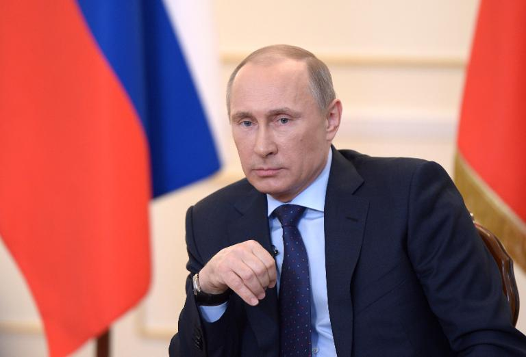 Russian President Vladimir Putin looks on during a press conference in Moscow, on March 4, 2014. PHOTO: AFP