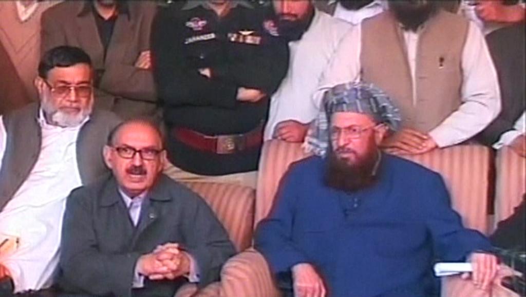 express news screengrab of jamiat ulema e islam samiul haq jui s chief maulana samiul haq r and coordinator of the government committee irfan siddiqi l