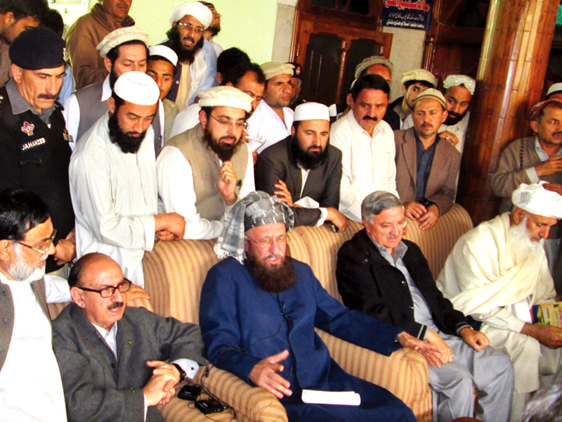 Maulana Samiul Haq and Irfan Siddiqui speak to journalists after their meeting in Akora Khattak. PHOTO: ONLINE