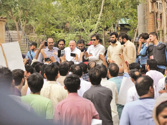 PTI Chief Imran Khan addresses protesting party workers outside his Bani Gala residence. PHOTO: ONLINE