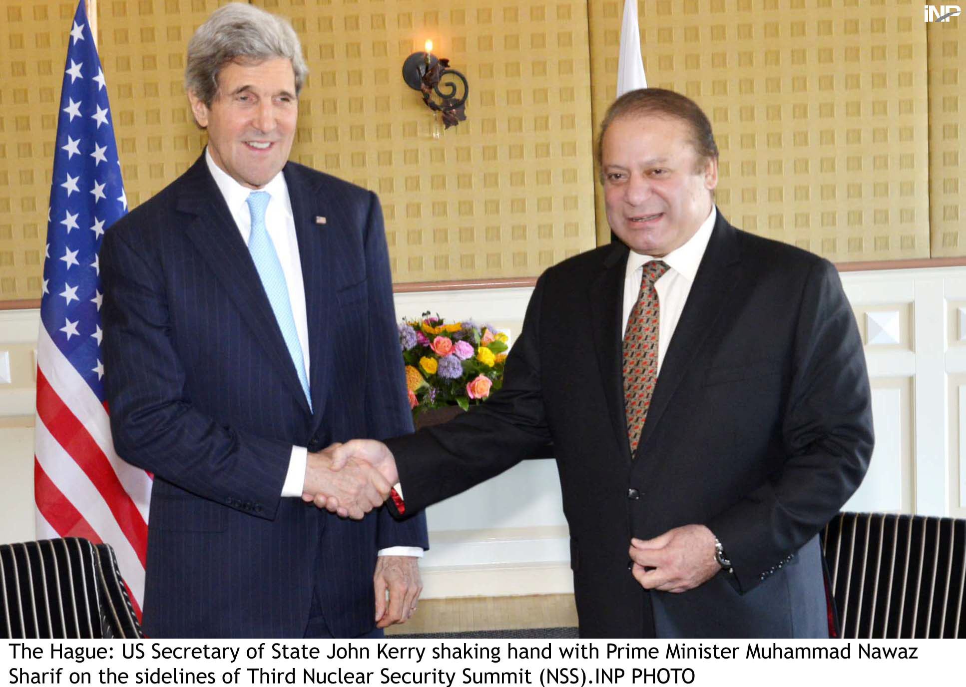 us secretary of state john kerry shakes hands with pm nawaz sharif photo inp