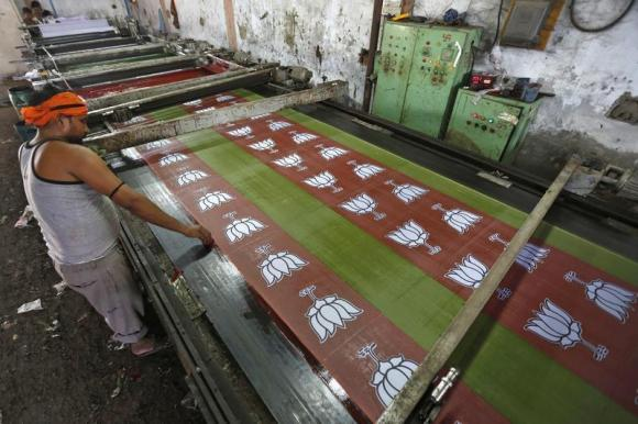 A worker prints the flags of India's main opposition Bharatiya Janata party (BJP) in a factory. PHOTO: REUTERS