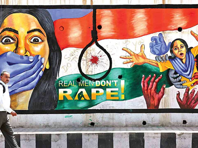 A man walks past a graffiti depicting a message in protest against rape, in Jammu on Sunday. PHOTO: REUTERS