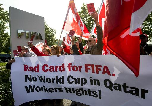members of building and wood workers 039 international bwi and swiss unia unions protest on october 3 2013 to support the rights of workers constructing stadiums for 2022 world cup host qatar photo afp