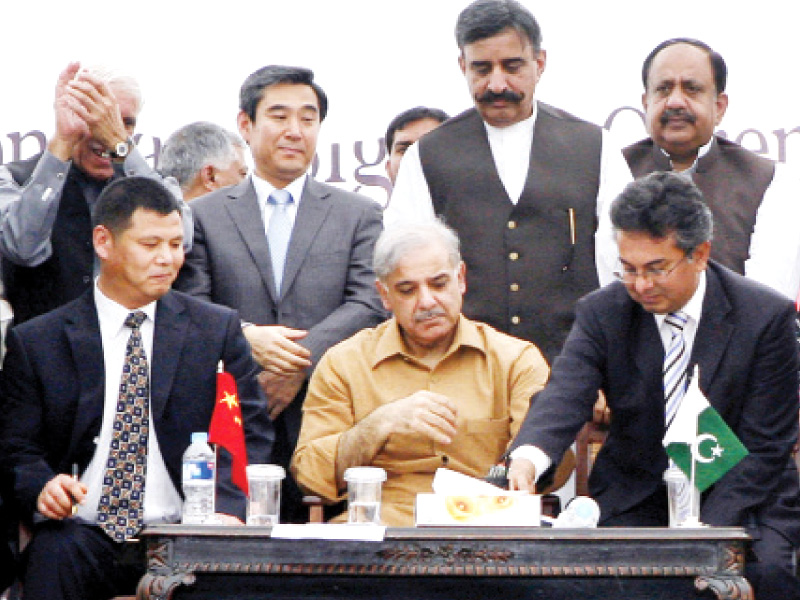 chief minister shahbaz sharif mcc overseas business director general xu youngjie and pmdc secretary dr arshad sign the contract photo dgpr