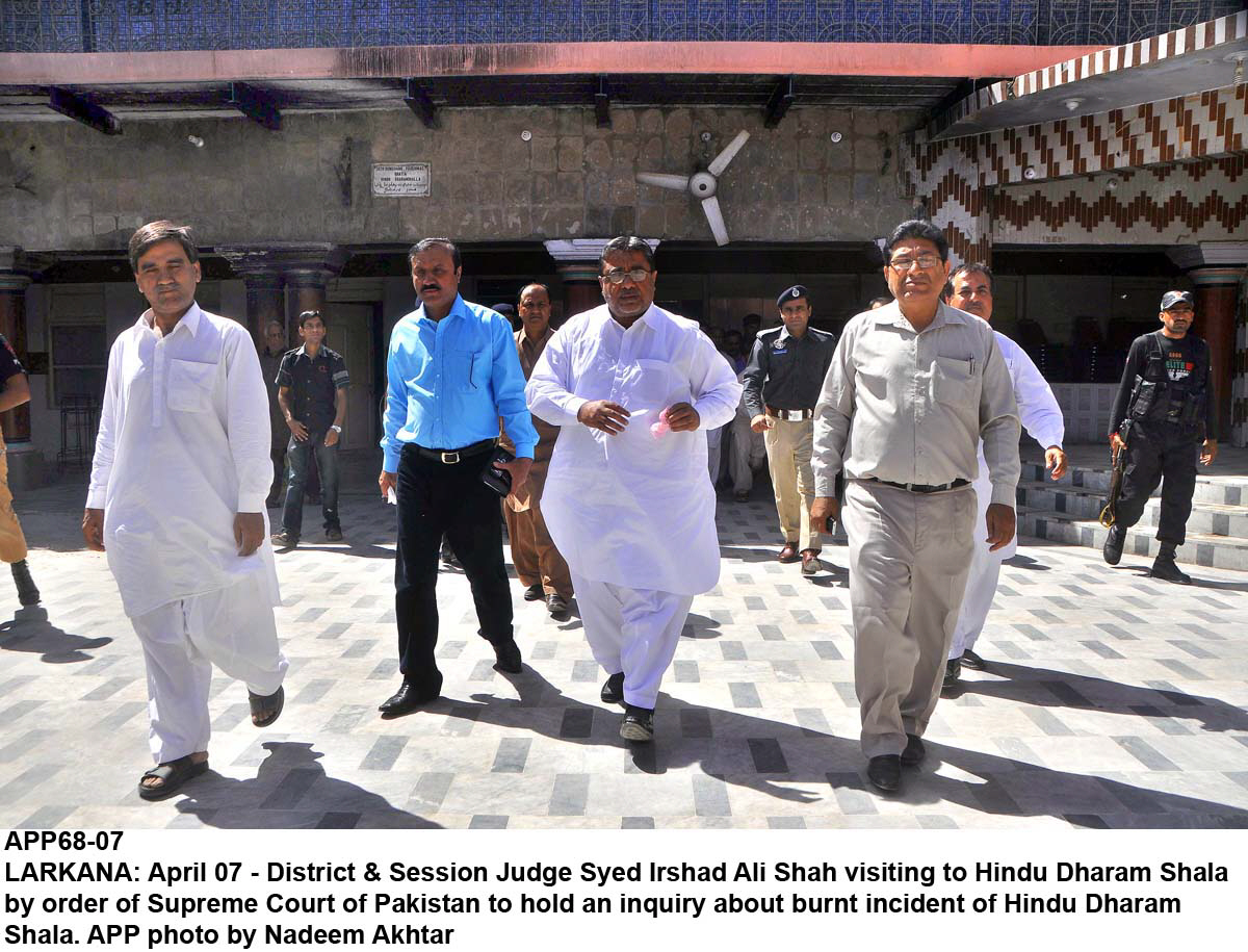 district and sessions judge syed irshad ali shah visiting the vandalised hindu dharam shala and temple in larkana on monday photo app