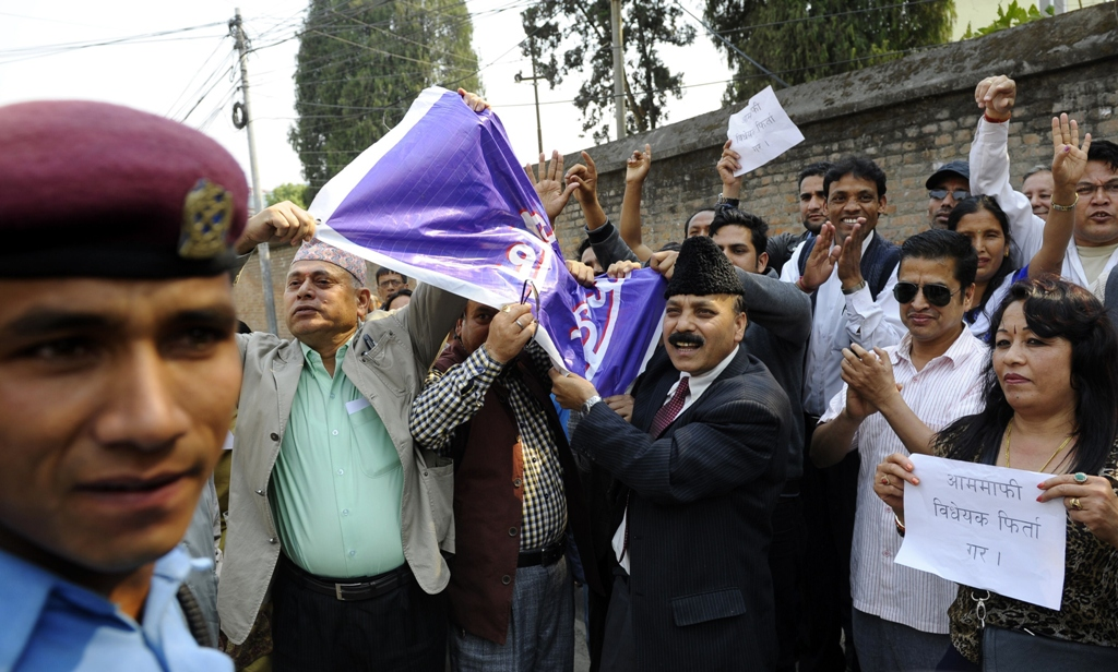 nepalese victims of war and human rights activists chant anti goverment slogans during a protest in front of government offices in kathmandu photo afp