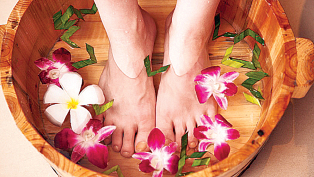 to bring the swelling down after a long hot day soak your feet in a tub of ice water for 15 minutes and then pat dry with a towel