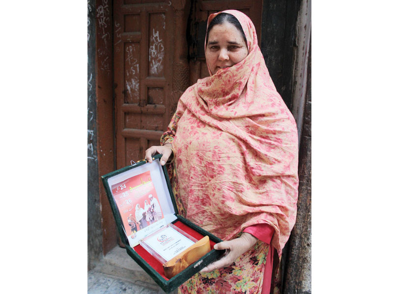 this lady health worker a widow has potentially safeguarded the lives of a thousand children through anti polio inoculations photo muhammad iqbal express