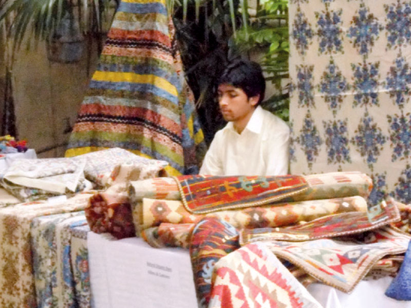 a man selling his crafts at the event photo express