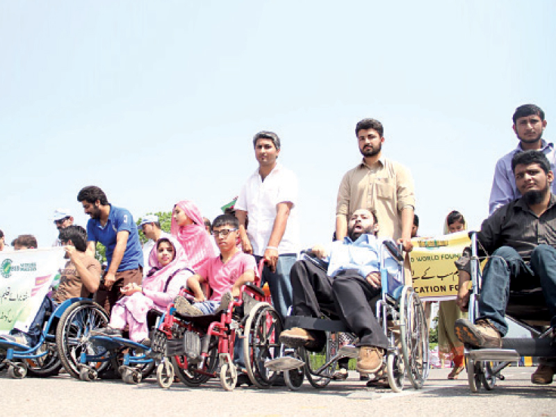 Girls and disabled children at the walk. PHOTO: INP