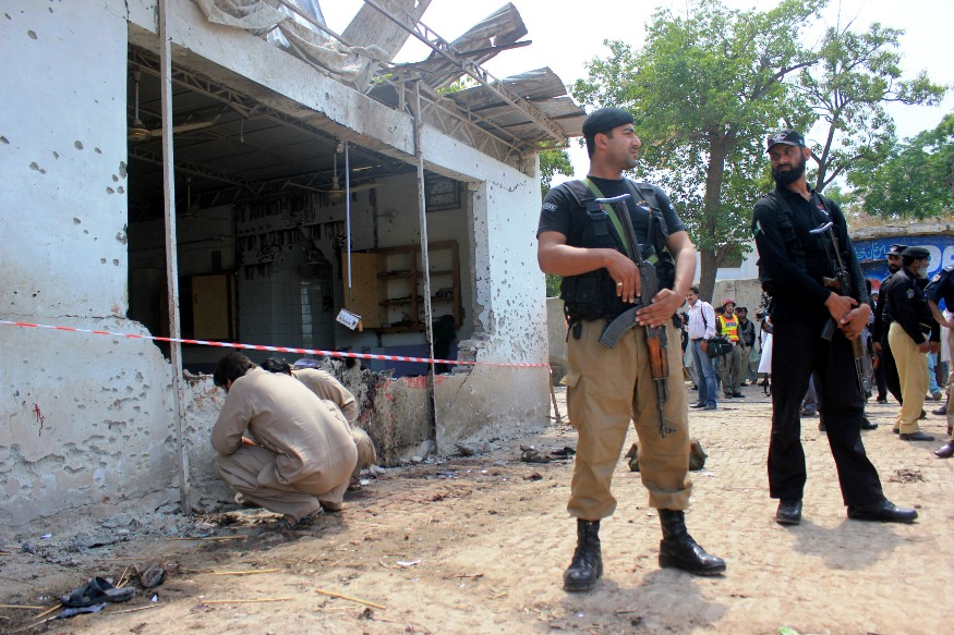 security officers stand guard near the blast site in peshawar photo muhammad iqbal express