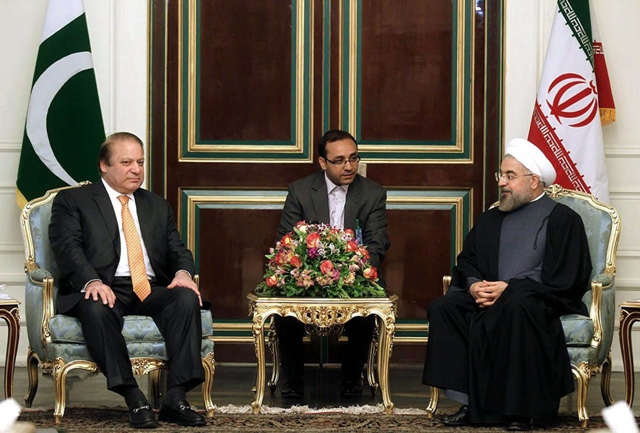 A handout picture released by the official website of the Iranian president show Iranian President Hassan Rowhani (R) with Nawaz Sharif (L) in Tehran on May 11. PHOTO: AFP/PRESIDENCY WEBSITE