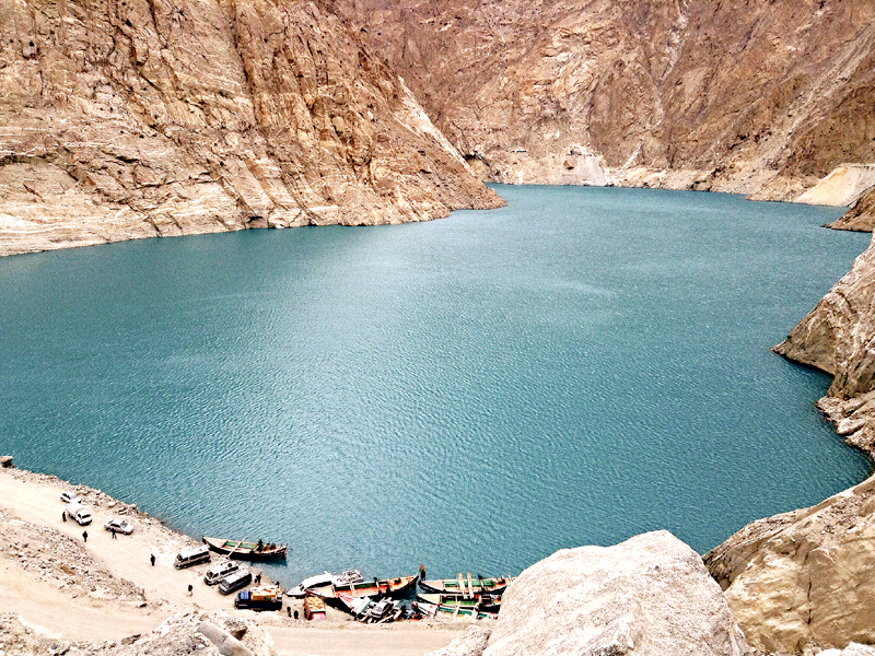 the attabad lake was formed following a massive landslide in 2010 which buried 20 people beneath it and blocked the flow of river hunza creating a natural dam the water has displaced thousands of people and inundated over 19 kilometres of the karakoram highway photo frida khan