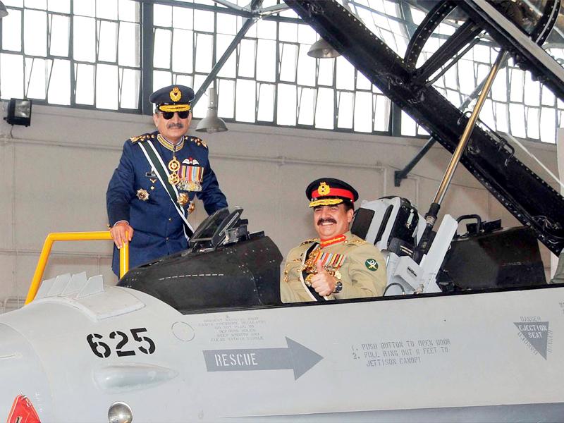 army chief gen raheel sharif inspects a newly arrived f 16 alongside air chief marshal tahir rafique butt photo inp
