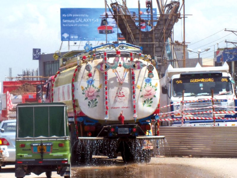 a water tanker being used to settle dust around murree road photo agha mehroz express