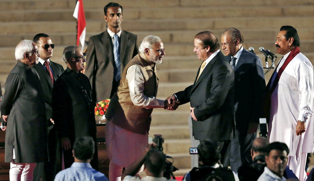 India's Prime Minister Narendra Modi (2L) is greeted by his Pakistani counterpart Nawaz Sharif (3rd R) after Modi took the oath of office at the presidential palace in New Delhi May 26, 2014. Also seen are India's President Pranab Mukherjee (L), Sri Lanka's President Mahinda Rajapaksa (R), and Mauritius Prime Minister Navinchandra Ramgoolam (2nd R). PHOTO: REUTERS