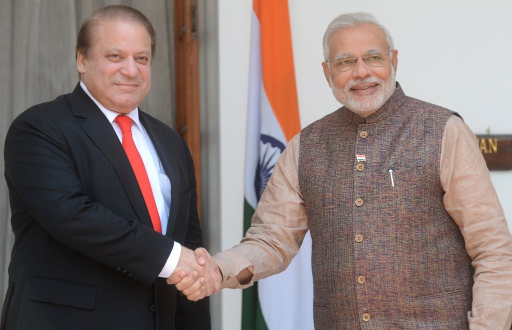 Prime Minister Nawaz Sharif (L) shaking hands with Indian premier Narendra Modi (R) just before the start of the bilateral meeting. PHOTO: AFP