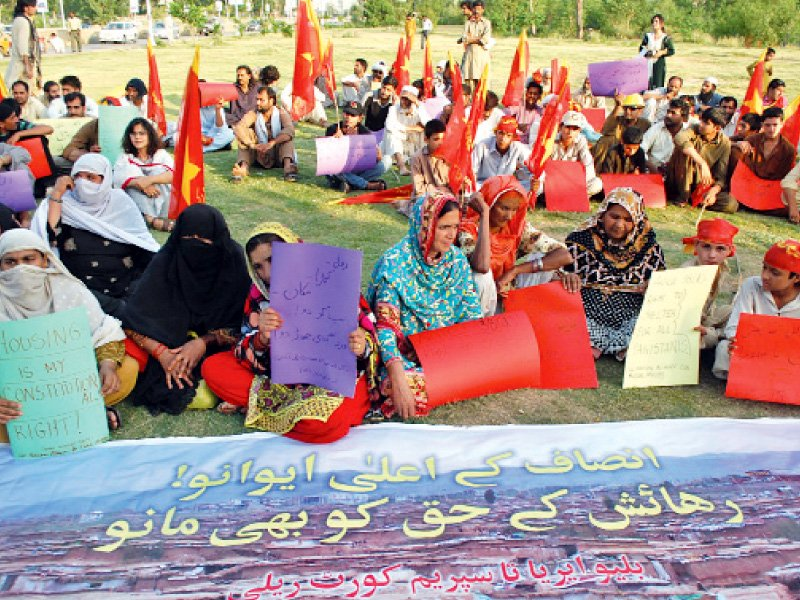 Activists of All Pakistan Alliance for Kachi Abadis and AWP stage a sit-in in Blue Area, Islamabad on Wednesday. PHOTO: MUHAMMAD JAVAID/EXPRESS
