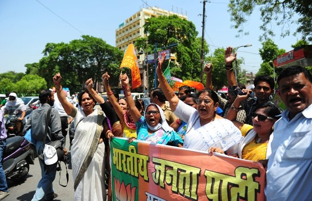 indian bharatiya janata party bjp supporters hold posters and chant slogans against the chief minister of the state of uttar pradesh akhilesh yadav as they take part in a protest against the gang rape and murder of two girls in the district of badaun in allahabad photo afp