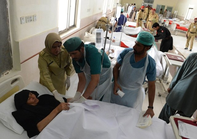 An injured pilgrim is treated at a hospital in Quetta following an attack in Taftan. PHOTO: AFP