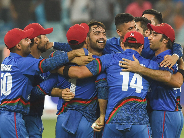 Afghan cricketer Rashid Khan (C) and captain Asghar Afghan (R) celebrate with teammates after the match tied against India in the Asia Cup in Dubai on September 25, 2018. PHOTO: GETTY