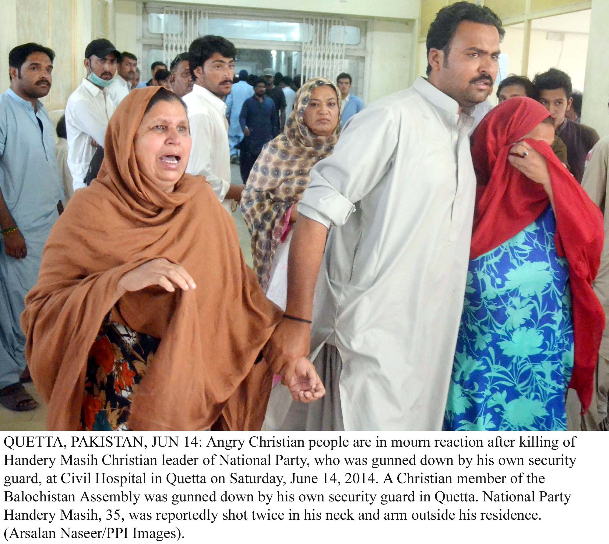 handery masieh 039 s relatives mourn his death at the civil hospital in quetta photo ppi