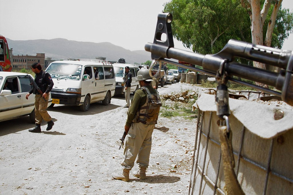 security personnel keep watch at a checkpoint in hangu on june 17 2014 photo afp