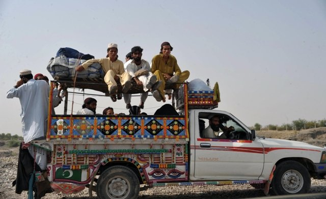 civilians fleeing from the military operation in north waziristan agency arrive in bakka khel in bannu district photo afp