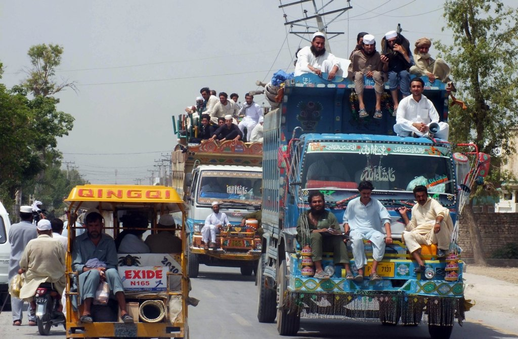 Civilians, fleeing from a military operation in North Waziristan tribal agency, arrive in Bannu district on June 18, 2014. PHOTO: AFP