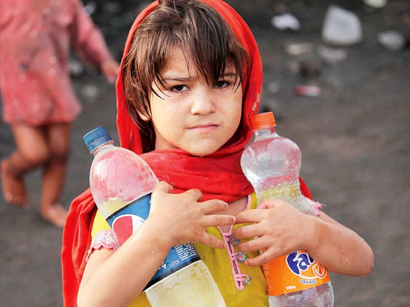 an afghan girl carries water bottles at her camp near band road photo online