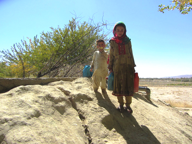 Local children fetching drinking water from the karez. PHOTO: RINA SAEED KHAN