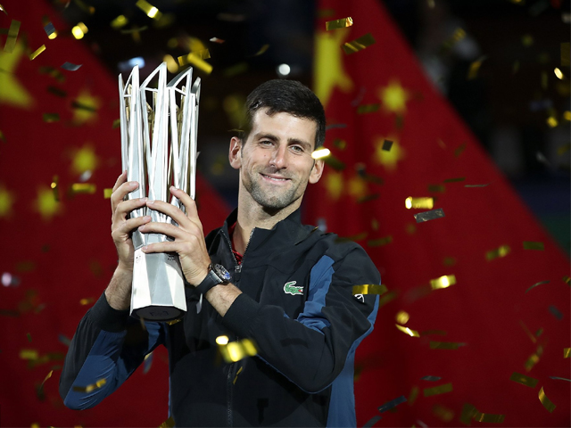 Novak Djokovic of Serbia poses with trophy after winning his men's singles final match against Borna Coric of Croatia on day 8 of Shanghai Rolex Masters on October 14, 2018 in China. PHOTO: GETTY