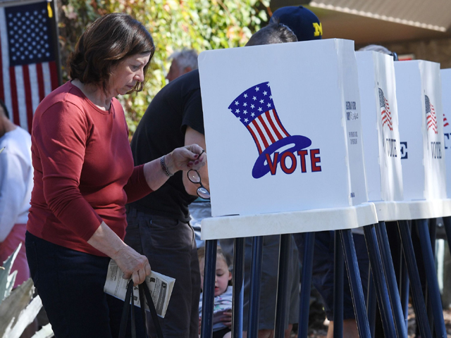 People vote at outdoor booths during early voting for the mid-term elections in Pasadena, California on November 3, 2018. PHOTO: AFP