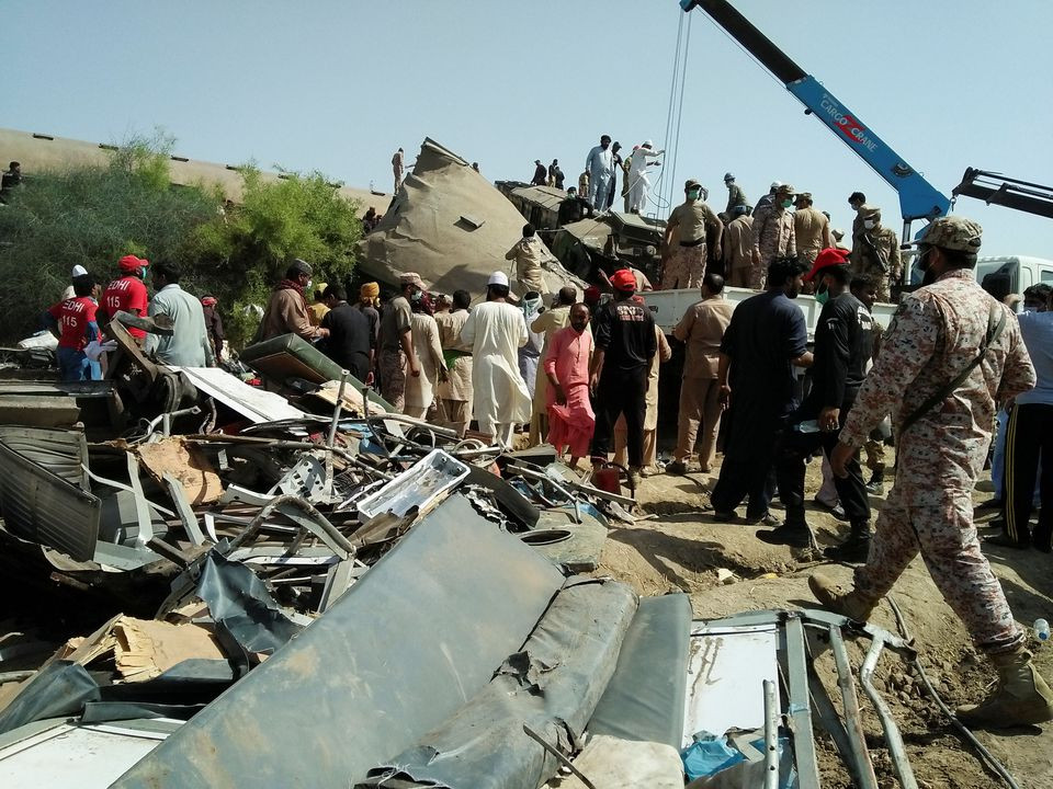 Paramilitary soldiers and rescue workers gather at the site following a collision between two trains in Ghotki, Pakistan. PHOTO: REUTERS