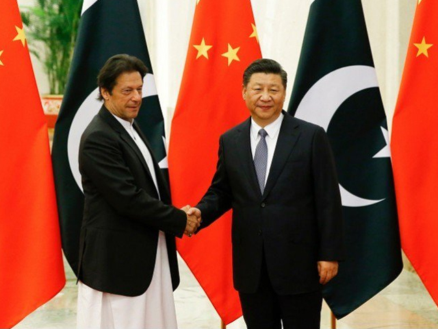 China's President Xi Jinping shakes hands with Prime Minister Imran Khan ahead of their meeting at the Great Hall of the People in Beijing on November 2, 2018 PHOTO:AFP