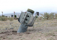 the-remains-of-a-rocket-shell-are-seen-near-a-graveyard-at-the-town-of-ivanyan-khojaly-in-the-breakaway-region-of-nagorno-karabakh-october-1-photo-reuters