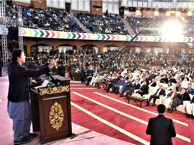 Prime Minister Imran Khan addressing the audience at the ceremony celebrating PTI's 100 days. PHOTO: APP