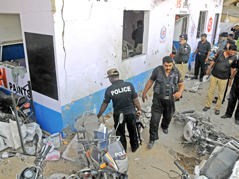 four cops injured in check post attack